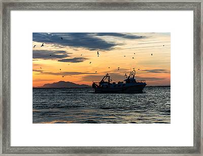 Fishing Boat At Sunset Framed Print by Tetyana Kokhanets