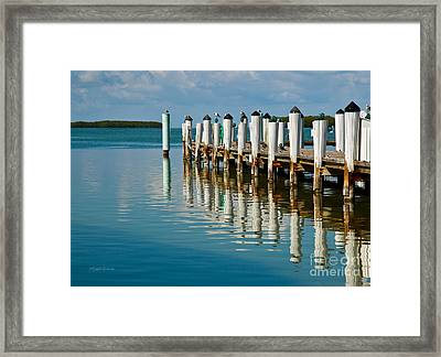 Fishing From The Pier Framed Print by Michelle Wiarda