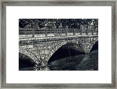 Fishing From The Stone Arched Bridge Framed Print by Robert Goudreau
