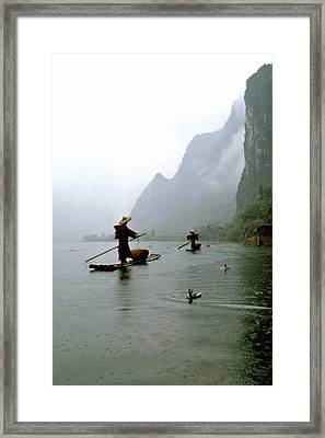 Fishing In The Rain With Cormorants Framed Print by King Wu