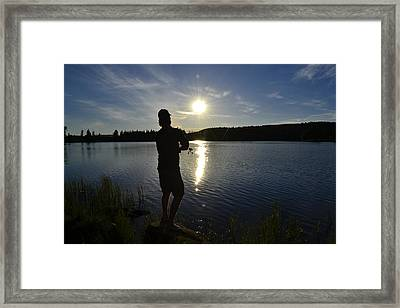 Fishing In The Sunset Framed Print by Per Kristiansen