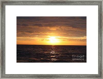 Fishing Into The Sunrise Framed Print by John Telfer