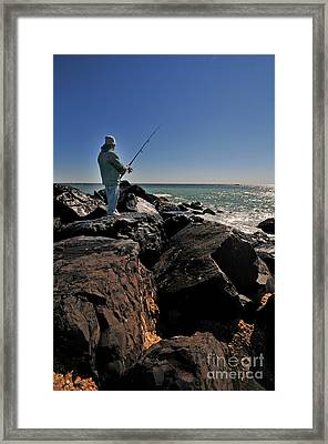 Fishing Off The Jetty Framed Print by Paul Ward