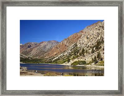 Fishing On Lundy Lake Framed Print by Rod Jones