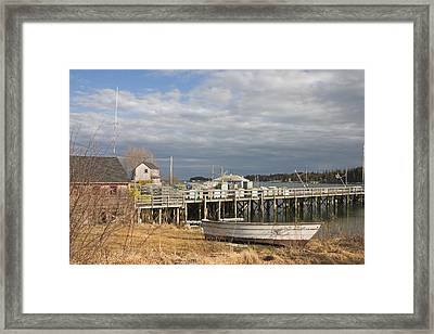 Fishing Pier And Rowboat In Tenants Harbor Maine Framed Print