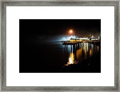 Fishing Pier At Night Framed Print by Brian Xavier