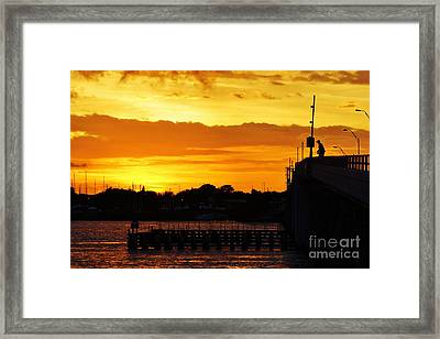 Fishing The Bridge At Sunset Framed Print
