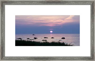 Fishing With Fire Framed Print by Dan Comeau