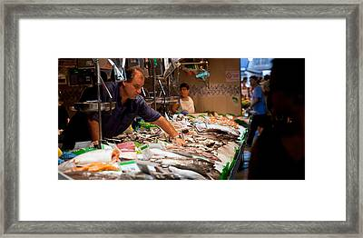 Fishmonger At A Fish Stall, La Boqueria Framed Print by Panoramic Images