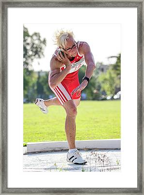 Fit Older Female Athlete Throws Shot Put Framed Print by Alex Rotas