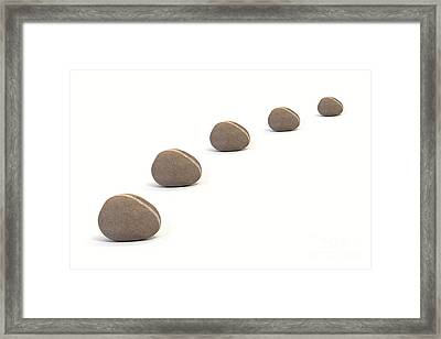 Five Calm Pebbles Against White Background Framed Print