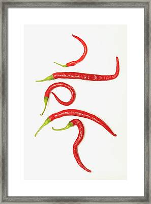 Five Red Jalapeno Peppers That Framed Print by John Short