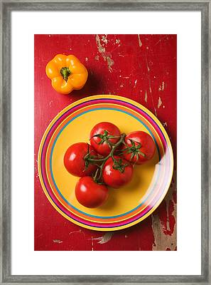 Five Tomatoes On Plate Framed Print