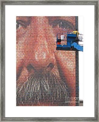 Fixing His Face Framed Print by Ann Horn