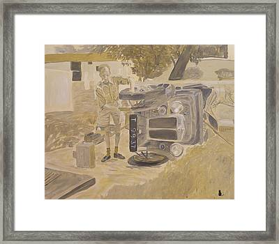 Fixing The Car Framed Print by Jonathan Laverick