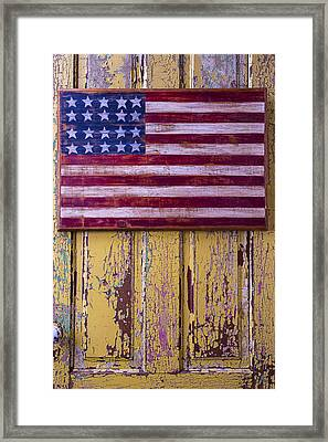 Flag On Old Yellow Door Framed Print
