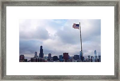 Framed Print featuring the photograph Flag Over City by Brigitte Emme