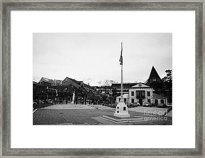 flagpole and waterfront Ushuaia Argentina Framed Print