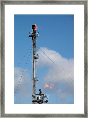 Flaring Off Gas At A Petrochemical Works Framed Print by Ashley Cooper