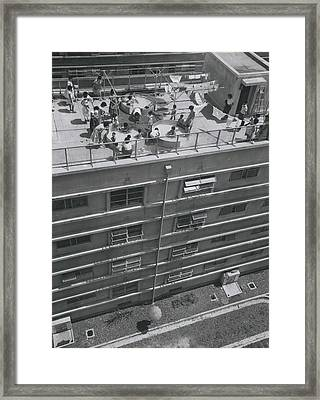 Flat Dwelliers Club Together To Buy Kids Roof Top Swimming Framed Print by Retro Images Archive