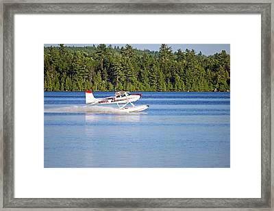 Framed Print featuring the photograph Float Plane Landing On The Lake by Barbara West