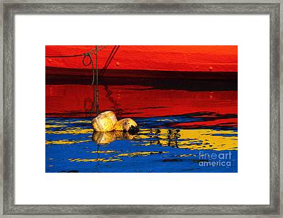 Floating Buoys And Reflections Framed Print by James Brunker