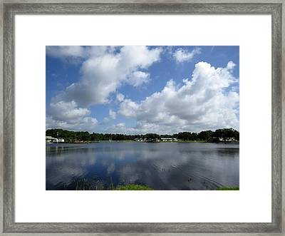 Floating Clouds Over The Lake Framed Print