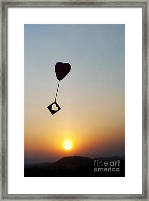 Floating Hearts Framed Print by Tim Gainey