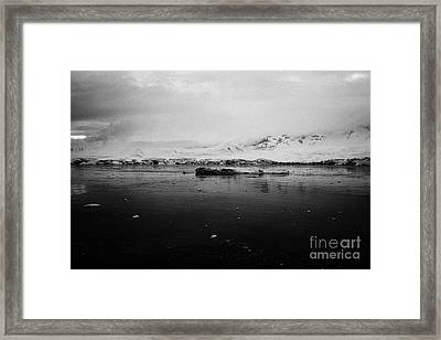 floating ice and snow covered landscape in Fournier Bay on Anvers Island Antarctica Framed Print by Joe Fox