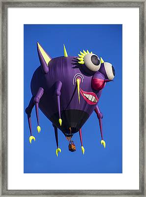 Floating Purple People Eater Framed Print