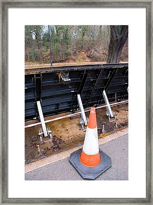 Flood Barrier In Appleby Framed Print by Mark Williamson