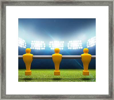 Floodlit Stadium With Foosball Players Framed Print by Allan Swart