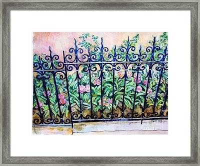 Flowers And Fence On Eighth Avenue Framed Print