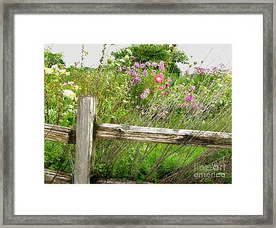 Flowers And Fences Framed Print by Marilyn Smith