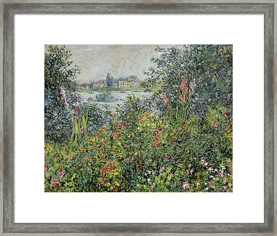 Flowers At Vetheuil Framed Print by Claude Monet