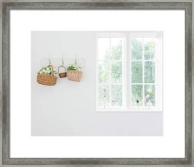 Flowers In Baskets On Wall Framed Print by Bloom Image
