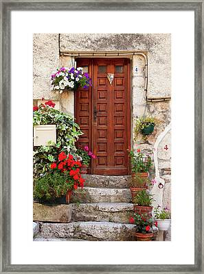 Flowers Surround The Front Door To Home Framed Print by Brian Jannsen