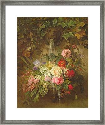 Flowers Under A Lion Fountain Framed Print