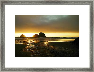 Flowing Into The Ocean Framed Print by Jeff Swan