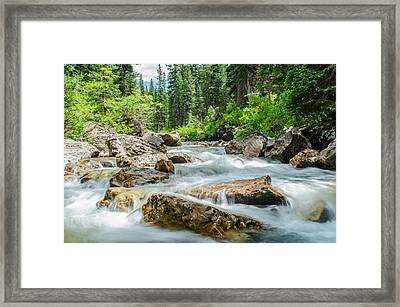 Flowing River Framed Print by Mike Schmidt