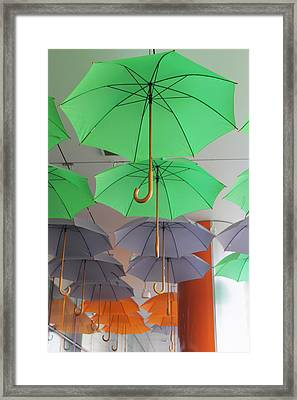 Flying Colorful Umbrellas  Framed Print by Diana Dimitrova