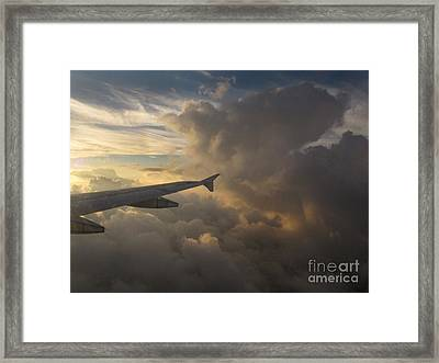 Framed Print featuring the photograph Flying In The Clouds by Inge Riis McDonald