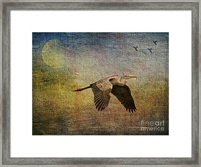 Flying Near The Moon Framed Print by Deborah Benoit