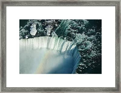 Flying Over Icy Niagara Falls Framed Print by Georgia Mizuleva