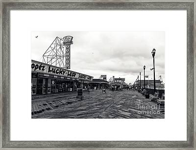 Flying Over The Boardwalk Mono Framed Print by John Rizzuto