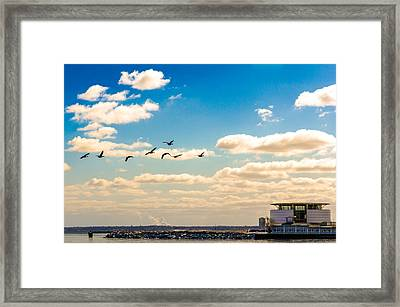 Framed Print featuring the photograph Flying To Discovery by Steven Santamour