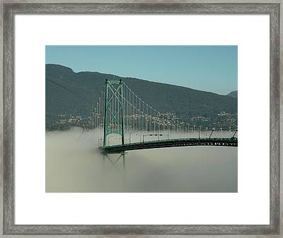 Fog Engulfing The Lion's Gate Bridge Framed Print by Brian Chase