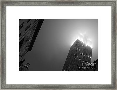 Foggy Empire Framed Print by Steven Macanka