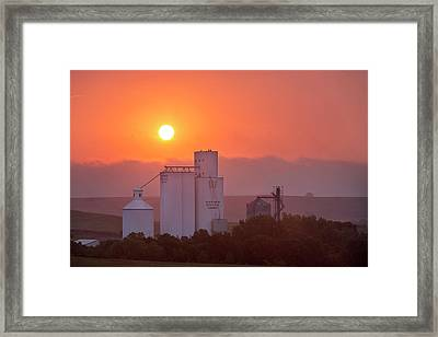 Foggy Sunrise Over Grain Elevator Framed Print by Chuck Haney