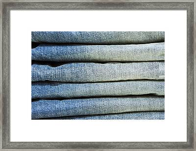 Folded Jeans Framed Print by Tom Gowanlock